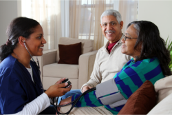 Consulting the health of an elderly woman with her husband.