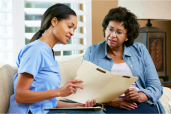 Explaining the insurances to an elderly woman.