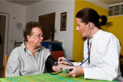 Nurse is checking up the health of an elderly woman.