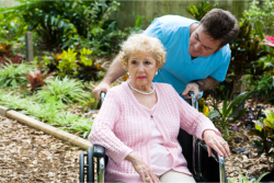 Occupational therapist evaluates the health of an elderly woman.
